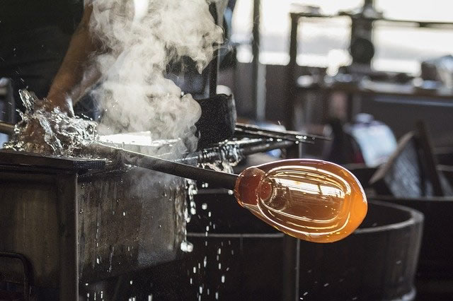 Picture of part of the process of blowing glass